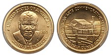 A gold medallion depicting a man and a rural farm scene