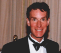 1999 Bill Nye receives Public Service Award from National Science Board (cropped to Nye shoulders).png