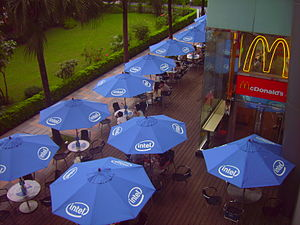 Garden furniture - An area of typical patio furniture, including umbrellas, in Taiwan.
