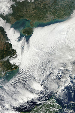 True color Aqua Satellite image of the South China Sea and Tropical Depression 26w on December 11, 2011. The near cloud-free Southern China and Vietnam can also be seen in the image.