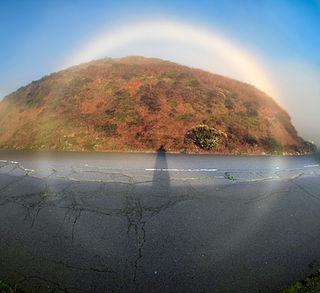 Fog bow type of rainbow formed by airborne water droplets