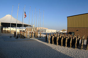 379th Air Expeditionary Wing - Airmen from the honor guard and the 379th Expeditionary Medical Group perform a retreat ceremony in 2006