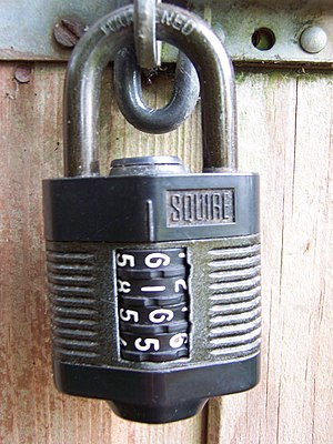 Four-digit combination padlock.