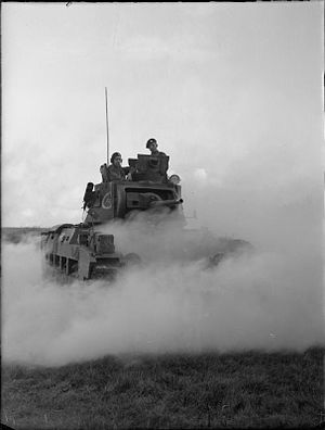 49th Royal Tank Regiment - Matilda tank of 49 RTR advances through a smoke screen during an exercise near Dover, UK, 23 October 1941
