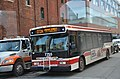A Toronto city bus runs through the historic district (27864868186).jpg