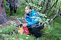 A botanist assesses the study area in a boreal forest (781d2ecf-ab1c-466a-8d3a-d078d8f0c4a1).jpg