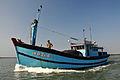 A fishing boat on the Thu Bon River, Vietnam.jpg