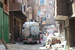 A garbage truck driving through the Streets of Manshiyat Nasser, Mokattam, Cairo.JPG
