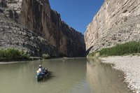 A guide from the Far Flung river-tour company brings up the rear of a canoe excursion by the Berkman family of Houston on the Rio Grande River through Santa Elena Canyon, deep in Big Bend National LCCN2014630612.tif