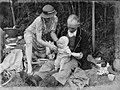 A man, a woman and a baby at a picnic (AM 86634-1).jpg