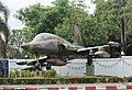 A retired F-5B in front of wing 23 gate Udon Thani International Airport.jpg