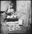 A soldier of the Republic of Korea Army eating lunch in a war-destroyed house in Munsan-ni, Korea, as a field ration... - NARA - 530635.tif