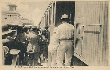 Abd-el-Krim boarding a Fez-Tangier train in 1926 on his way to exile in the Indian Ocean island of Reunion Abd el-Krim, Fes 1926.jpg