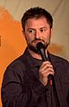 Adam Cayton-Holland performing stand-up comedy.jpeg