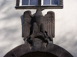 Technische Universität Darmstadt - Eagle above the rear main entry to the Robert Piloty Building, nowadays home to the Department of Computer Science. Note the effaced swastika under the eagle