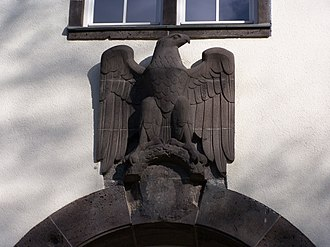Denazification - Eagle above the rear main entry to the Robert-Piloty building, department of Computer Science, Darmstadt University of Technology. Note the effaced swastika under the eagle.