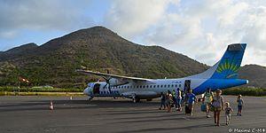 Grand Case-Espérance Airport - Passengers deboard an Air Caraïbes ATR 72 at L'Espérance Airport (2015)
