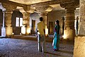 Ajanta Caves, India, Pillared hall of ancient Buddhist temple, magical atmosphere.jpg
