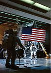 Al Shepard photographs Ed Mitchell and the flag during indoor EVA training.jpg