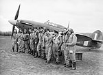 American pilots of No. 71 (Eagle) Squadron RAF gathered in front of one of their Hawker Hurricanes at Kirton-in-Lindsey, Lincolnshire, 17 March 1941. CH2403.jpg