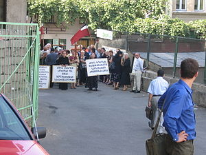 George Soros - Protesters in Tbilisi with flag of the Democratic Republic of Georgia blocking the way from the Open Society Institute office, 2005