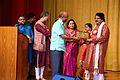 Arabinda Muduli recieving memento from Sunil Jain, Ambassador of India at Embassy of India, Kuwait 02.JPG