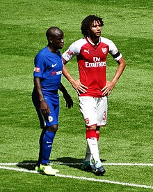 97c527eff4a Mohamed Elneny - Elneny (right) playing for Arsenal against rival club  Chelsea in the