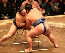 A sumo match (tori-kumi) between former yokozuna Asashōryū (left) and then-komusubi Kotoshōgiku in January 2008.