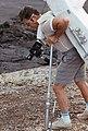 Astronaut James Irwin simulates using lunar surface geological tools.jpg