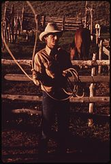 At the Oldlands' Summer Cow Camp, Fifteen Miles South of Their Piceance Creek Ranch. Hired Hand Jake Milton Spends an Idle Moment Practicing Roping, 07-1973 (3815837186).jpg