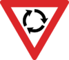 Australian Roundabout warning sign.png