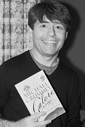 Michael Crummey - Author Michael Crummey poses with a copy of his book, Galore, at a fundraiser for the Writers' Trust of Canada