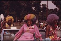BLACK BEAUTIES WITH COLORFUL HAIR GRACE A FLOAT DURING THE ANNUAL BUD BILLIKEN DAY PARADE ALONG DR. MARTIN L. KING... - NARA - 556282.jpg