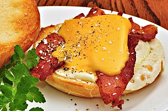 Bacon, egg and cheese sandwich - An open bacon, egg, and cheese sandwich