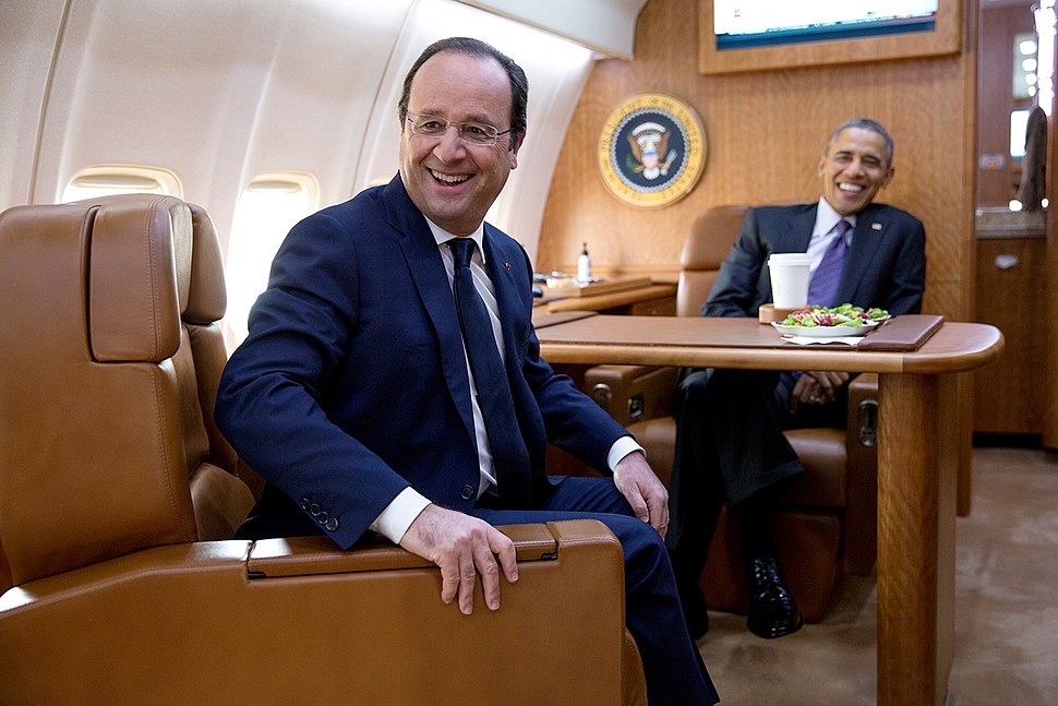 Barack Obama and François Hollande on board Air Force One February 2014
