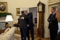 Barack Obama hugs John Kerry in the Oval Office.jpg