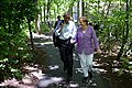 Barack Obama talks with Chancellor Angela Merkel as they walk to Aspen Cabin during the G8 Summit at Camp David, 2012.jpg