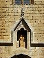 Beaumont-du-Périgord église portail sud niche.JPG