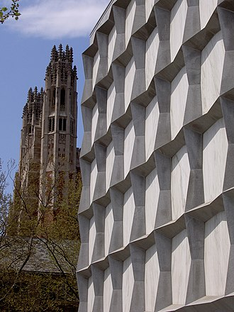 Beinecke Rare Book & Manuscript Library - Beinecke's starkly geometric exterior, with the Yale Law School Gothic spires in the background