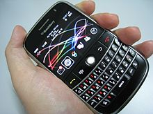 Blackberry Held In Hand Featuring All The Diffe Selective Hardware And On Screen