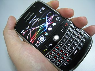 BlackBerry - BlackBerry held in hand featuring all the different selective hardware and software on the screen.