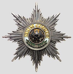 "Suum cuique - Medal of the Order of the Black Eagle, with the motto ""SUUM CUIQUE"" in the center."