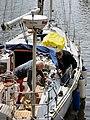 Boat men (9049929161).jpg