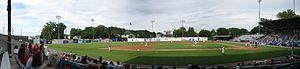 BB&T Ballpark at Historic Bowman Field - Panoramic view of Bowman Field from the third base side – the Crosscutters (in white and red uniforms) are playing the Auburn Doubledays in a June 2012 game