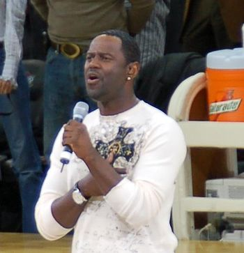 Brian McKnight appears to be singing the natio...