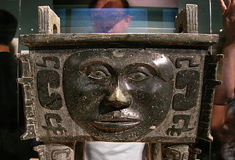 Ding (vessel) - Square ding; the human face is a highly unusual decoration