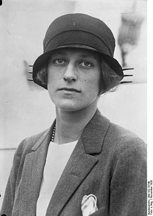 Mushroom hat - 1920s mushroom hats often resembled the cloche hat, but with the addition of a neat brim, such as this model worn by Isabel Rockefeller