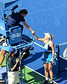 Caroline Wozniacki Shaking the Judges Hand After Her First Round Victory (9617196128).jpg
