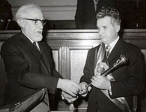 Nicolae Ceaușescu's cult of personality - Ceaușescu receiving the presidential sceptre from the Chairman of the Grand National Assembly, Ştefan Voitec, to mark his election as President of Romania, 28 March 1974