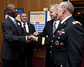 Chairman of the Joint Chiefs of Staff Army Gen. Martin E. Dempsey, right, and Gen. James F. Amos, second from right, the commandant of the Marine Corps, meet with retired Marine Corps Sgt. Maj. Kevin Bennett 120906-A-TT930-012.jpg